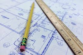 Blueprints with pencil and ruler sitting on top