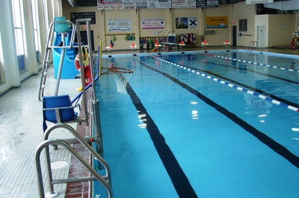 Indoor swimming pool lanes and lifeguard chair