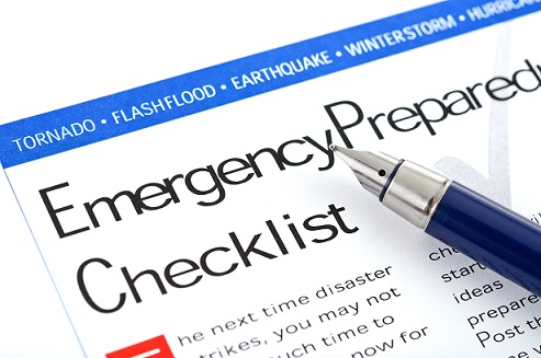 Paper that says Emergency Preparedness with a pen