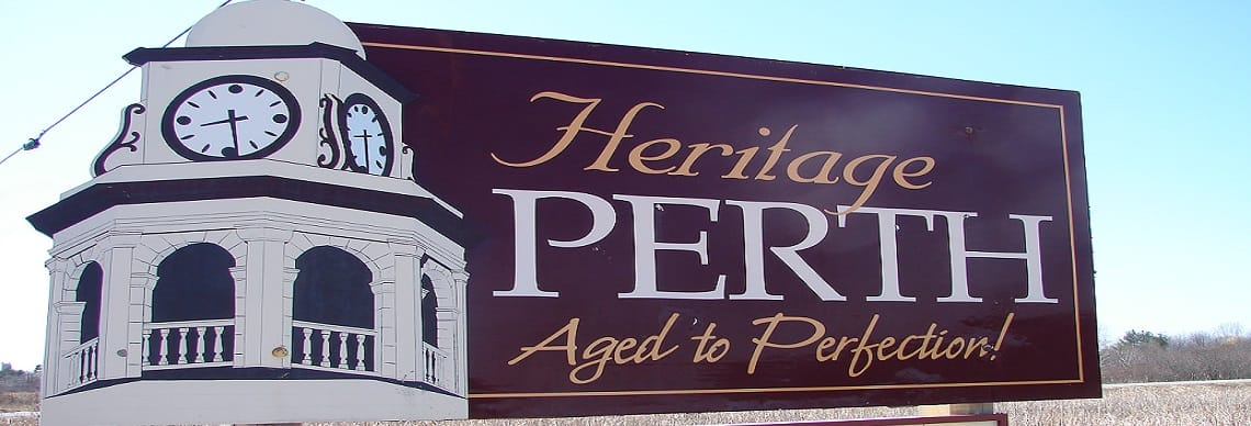 Maroon sign that says Heritage Perth Aged to Perfection